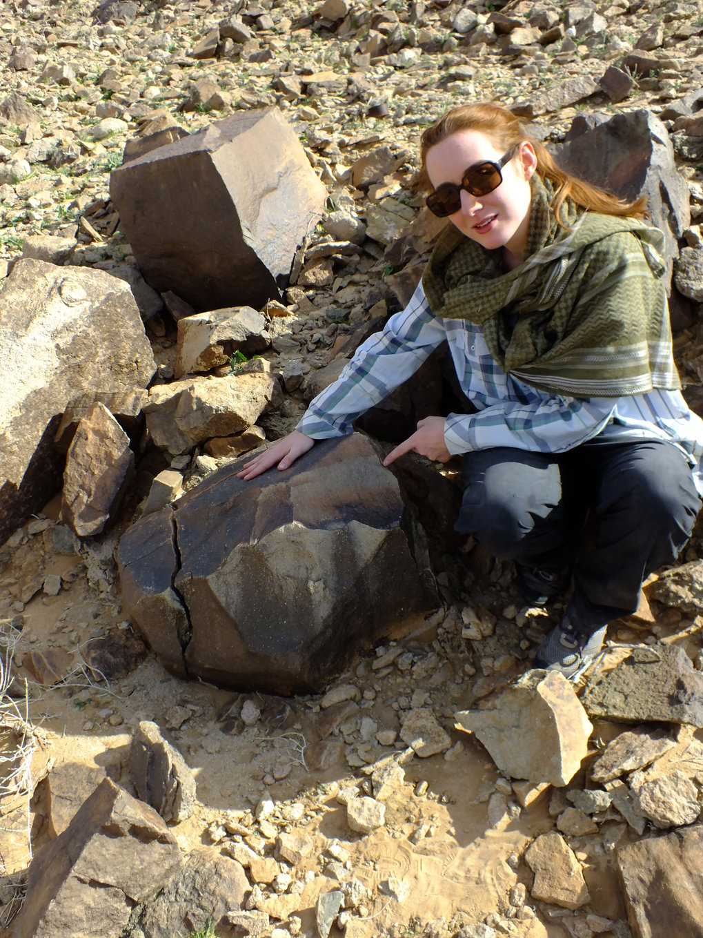 Researcher Eleanor Scerri with giant Acheulean core from which flakes were struck to create the handaxes.