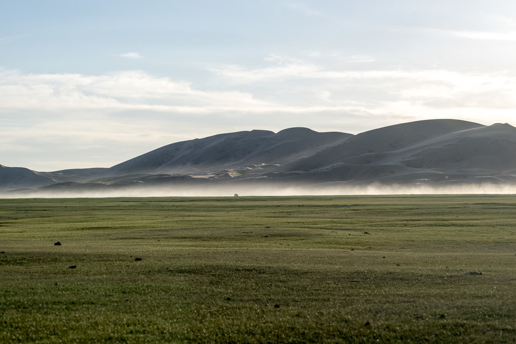 The sand dunes of Mongol Els jutting out of the steppe in Mongolia. Many of these desert barriers only appeared after the Last Glacial Maximum (~20,000 years ago).