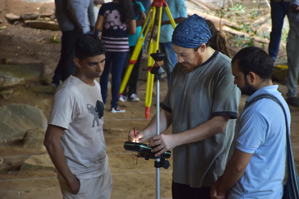 James Blinkhorn instructing Sri Lankan colleagues in the use of an electronic Total Station as part of Department of Archaeology fieldwork at Rajagala, Sri Lanka.