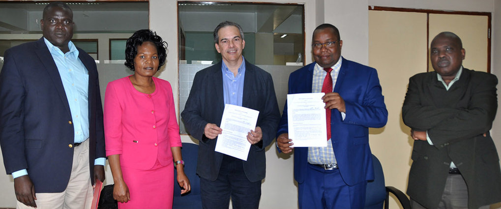 Prof. Michael Petraglia and colleagues from the National Museums of Kenya, including Director General Dr. Mzalendo Kibunjia, at the MOU signing.