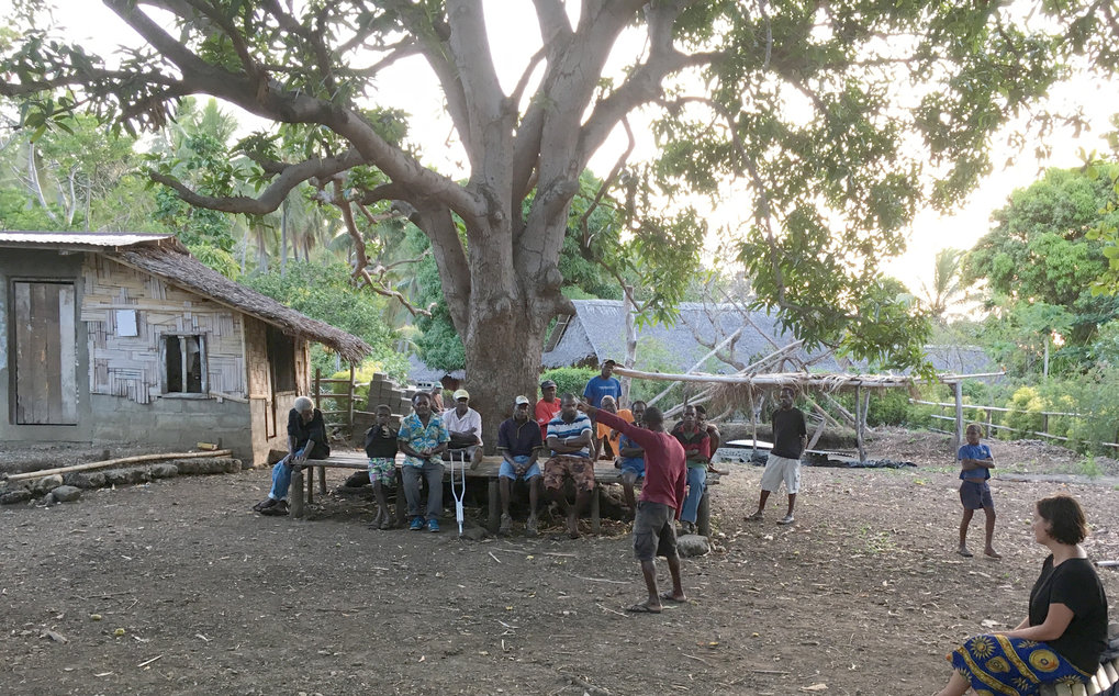 Kaitip Kami, curator of the National Museum of Vanuatu, and Dr. Heidi Colleran providing explanation of the genetics research to a local community in Northwest Malakula, Vanuatu.